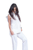 Fashion woman wear white pants and shirt isolated over white Stock Photo