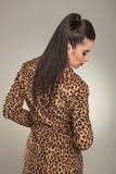 Fashion woman wearing a animal print coat looking down Stock Images