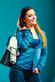 Fashion woman wearing blue denim with bag Stock Photography