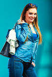 Fashion woman wearing blue denim with bag Royalty Free Stock Images