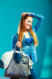 Fashion woman wearing blue denim with bag Royalty Free Stock Photography