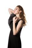 Fashion woman wearing an elegant black dress with boot and winter fur hat Royalty Free Stock Image