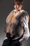 Fashion woman wearing fur jerkin Royalty Free Stock Photography