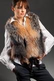 Fashion woman wearing fur jerkin Royalty Free Stock Photos