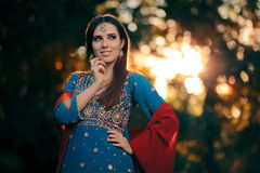 Fashion Woman Wearing Indian Costume and Jewelry Set. Beautiful girl wearing a salwar kameez with matching earrings, mangtika and necklace Royalty Free Stock Image