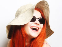 Fashion woman wearing sunglasses and hat. Royalty Free Stock Image