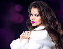 Fashion woman in white fur coat, beauty lady model portrait. Sen Stock Images