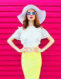 Fashion woman in white summer straw hat and skirt over colorful pink Stock Image