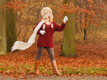 Fashion woman in windy fall autumn park forest. Stock Photos