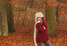 Fashion woman in windy fall autumn park forest. Stock Images