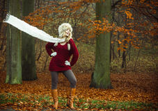 Fashion woman in windy fall autumn park forest. Stock Photo