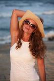 Fashion woman wit hat on sunny day at sea Stock Photos
