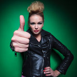 Fashion womanin leather jacket making the ok thumbs up sign Royalty Free Stock Images