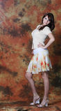 Fashion women. The beautiful girl poses on an abstract background Royalty Free Stock Image