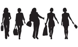 Fashion women. Vector. Silhouettes of the womans on white background stock illustration