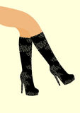 Fashion for women beautiful legs in high boots with a pattern Royalty Free Stock Photography