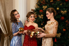 Fashion women exchanging gifts Stock Image