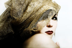 Fashion women in golden boa. Portrait Royalty Free Stock Image