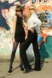 Fashion women at the graffiti wall Stock Photo