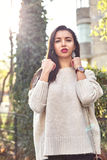 Fashion women in nude sweater stock images