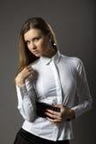 Fashion women over gray stock image