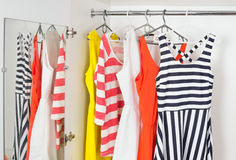 Fashion women's dresses on hangers Royalty Free Stock Photo