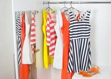 Fashion women's dresses on hangers Royalty Free Stock Photos