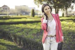 Fashion women smiling. Fashion woman smiling in pink jaacket stock photos