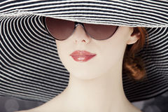 Fashion women in wide hat Stock Image
