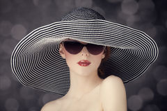 Fashion women in wide hat Stock Images