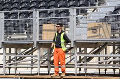 Fashion worker on the construction of spectator seats in Baku royalty free stock photography