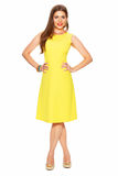 Fashion yellow dress. Smiling woman full body portrait white ba Royalty Free Stock Photography