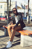 Fashion young african man wearing a sunglasses and black jacket Stock Image