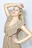 Fashion young blond girl. Studio pose Royalty Free Stock Photos