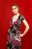 Fashion young blonde. Standing with hands on hips looking appear stock image