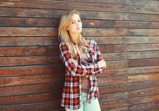 Fashion young blonde woman in checkered shirt Royalty Free Stock Photography