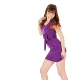 Fashion young brunette in magentas dress posing Royalty Free Stock Image