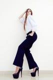 Fashion young business woman wearing man's shirt on white Stock Photo