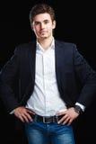 Fashion young businessman black suit Stock Photo