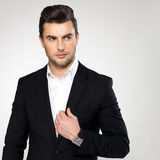 Fashion young businessman in black suit Stock Photography