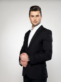 Fashion young businessman in black suit Royalty Free Stock Image