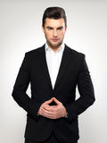 Fashion young businessman in black suit. Fashion young businessman black suit casual  poses at studio Stock Images