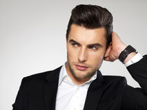 Fashion young businessman in black suit. Fashion young businessman black suit casual  poses at studio Royalty Free Stock Photo