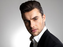Fashion young businessman in black suit. Fashion young businessman black suit casual  poses at studio Stock Photo