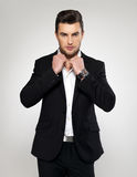 Fashion young businessman in black suit. Fashion young businessman black suit casual  poses at studio Stock Photography