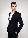 Fashion young businessman in black suit. Fashion young businessman black suit casual  poses at studio Stock Photos