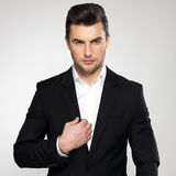 Fashion young businessman in black suit. Fashion young businessman black suit casual  poses at studio Royalty Free Stock Photography
