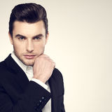 Fashion young businessman in black suit Royalty Free Stock Photo