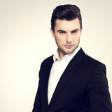 Fashion young businessman in black suit Royalty Free Stock Photography