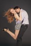 Fashion young couple, studio shot on black Stock Images